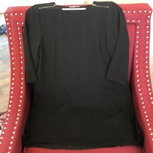 Black tunic with a pleated shear back.